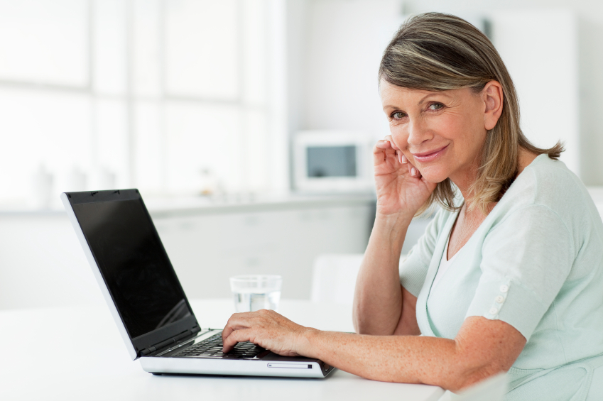 Senior woman at home on a laptop